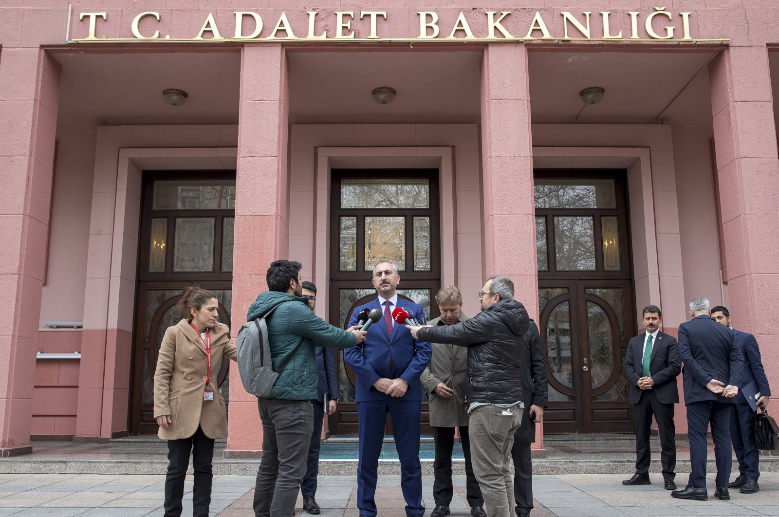 Justice Minister Abdulhamit Gül answers journalists' question in front of the ministry, March 20, 2020 (AA Photo)
