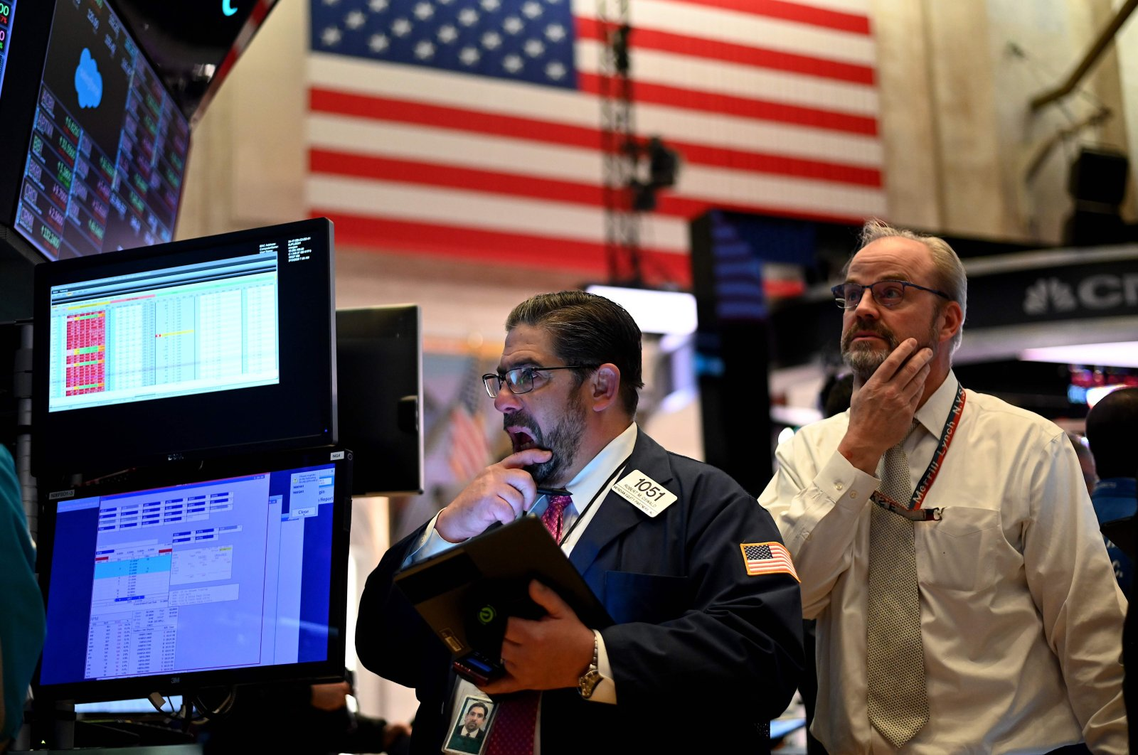 In this file photo taken on March 18, 2020 Traders work during the closing bell at the New York Stock Exchange (NYSE) at Wall Street in New York City. (AFP Photo)