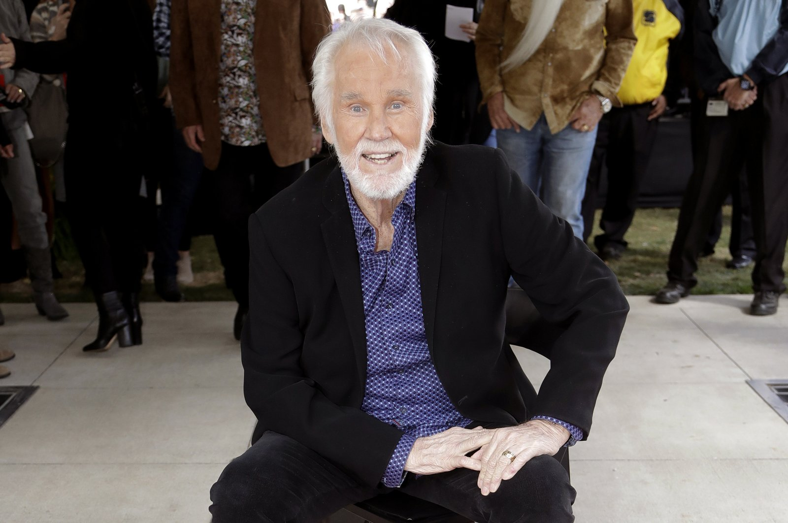 In this Oct. 24, 2017 file photo, Kenny Rogers poses with his star on the Music City Walk of Fame in Nashville, Tenn. (AP Photo)