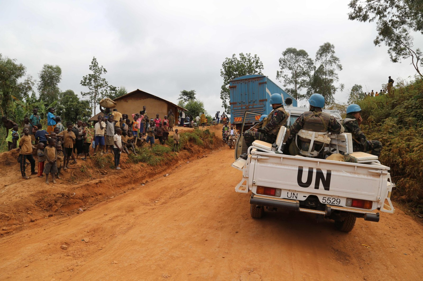 In this photograph taken on March 13, 2020, Moroccan soldiers from the UN mission in DRC (Monusco) ride in a vehicle as they patrol in the violence-torn Djugu territory, Ituri province, eastern DRCongo. (AFP Photo)