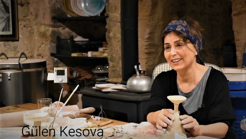Gülen Kesova poses while making a ceramic vase. (AA Photo)