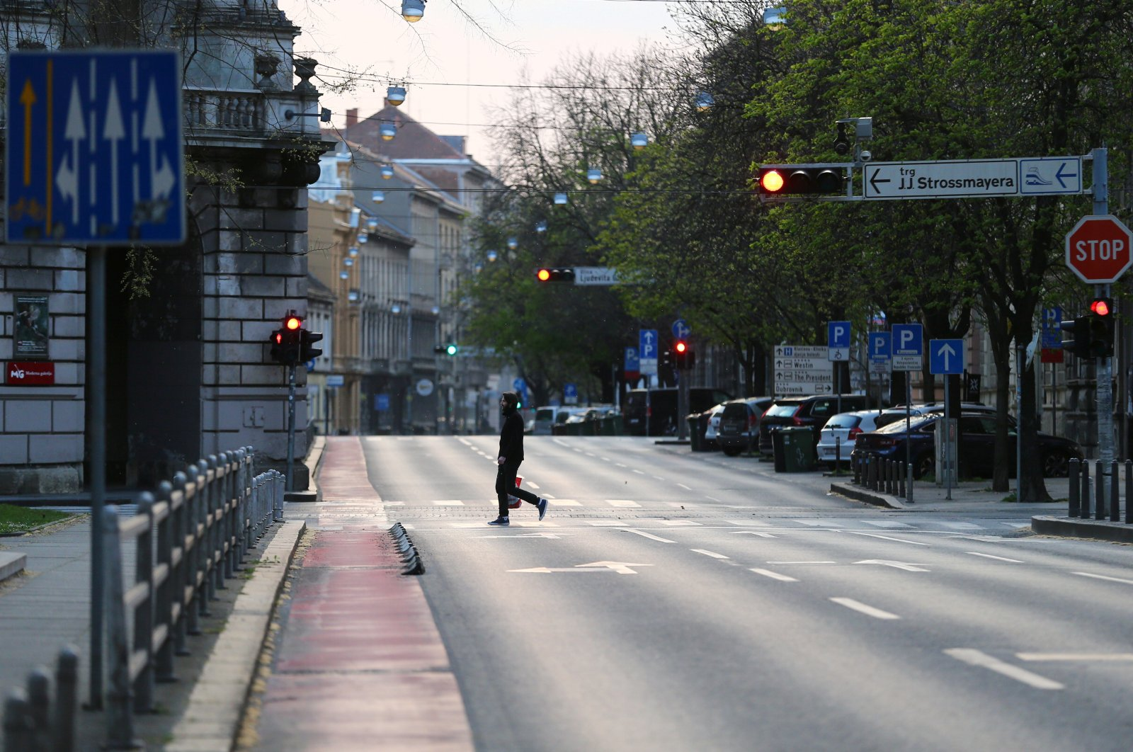 A man crosses a street in Zagreb, Croatia, where authorities have been stepping up measures to fight the coronavirus outbreak, March 21, 2020. (Reuters Photo)