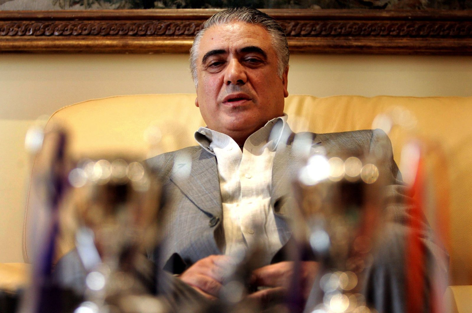 Former Real Madrid FC President Lorenzo Sanz poses with his trophies in Madrid, June 15, 2006. (AFP Photo)