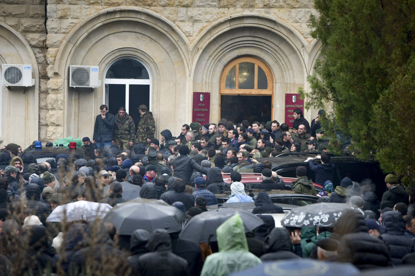 In this Jan. 9, 2020, file photo, protesters besiege the offices of Abkhazia President Raul Khadzhimba in the city of Sukhumi, in Georgia's breakaway province of Abkhazia. (AP Photo)