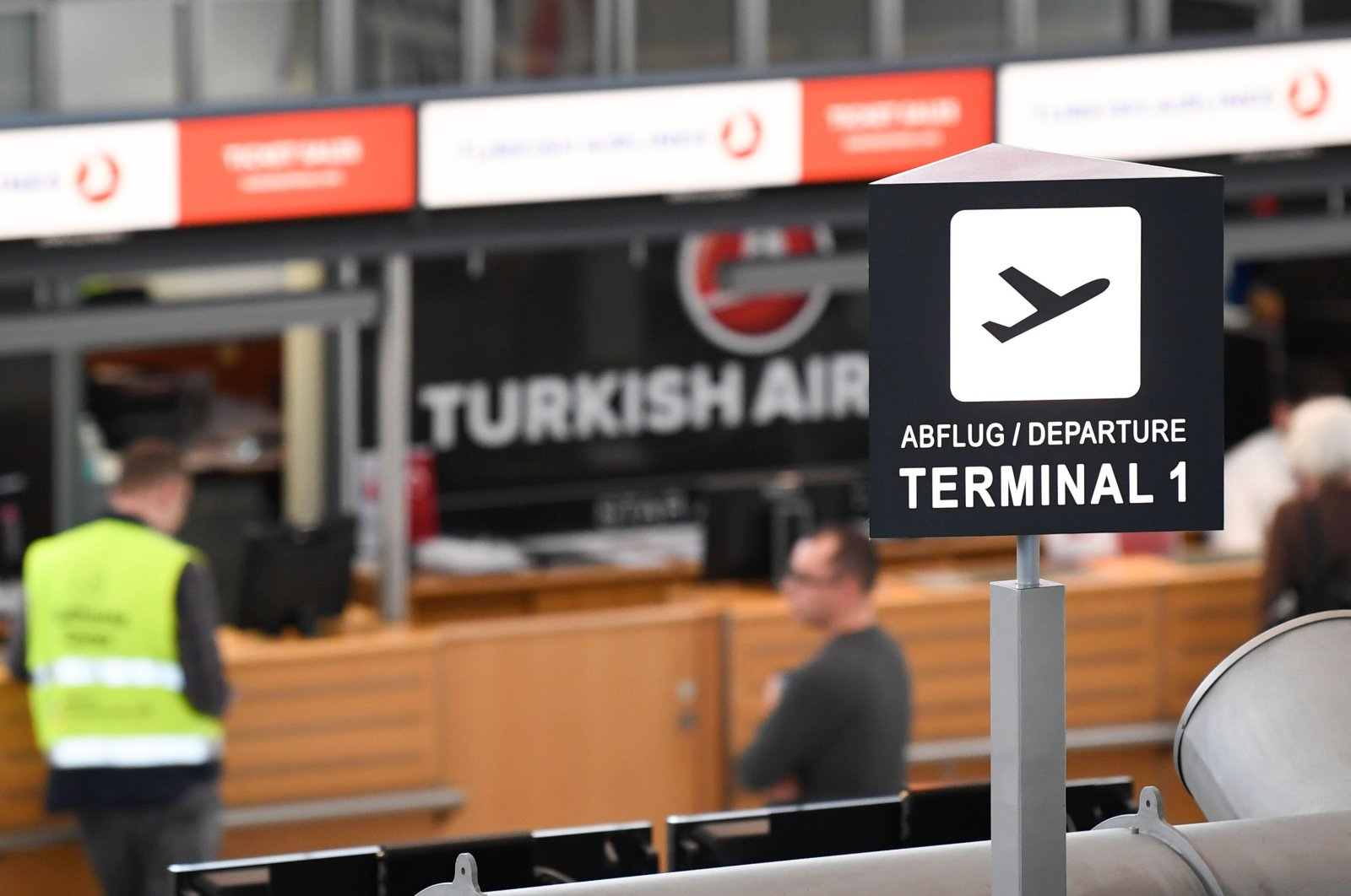 Few people stand at the counter of Turkish Airlines at the airport in Stuttgart, southern Germany, on March 16, 2020. (AFP Photo)