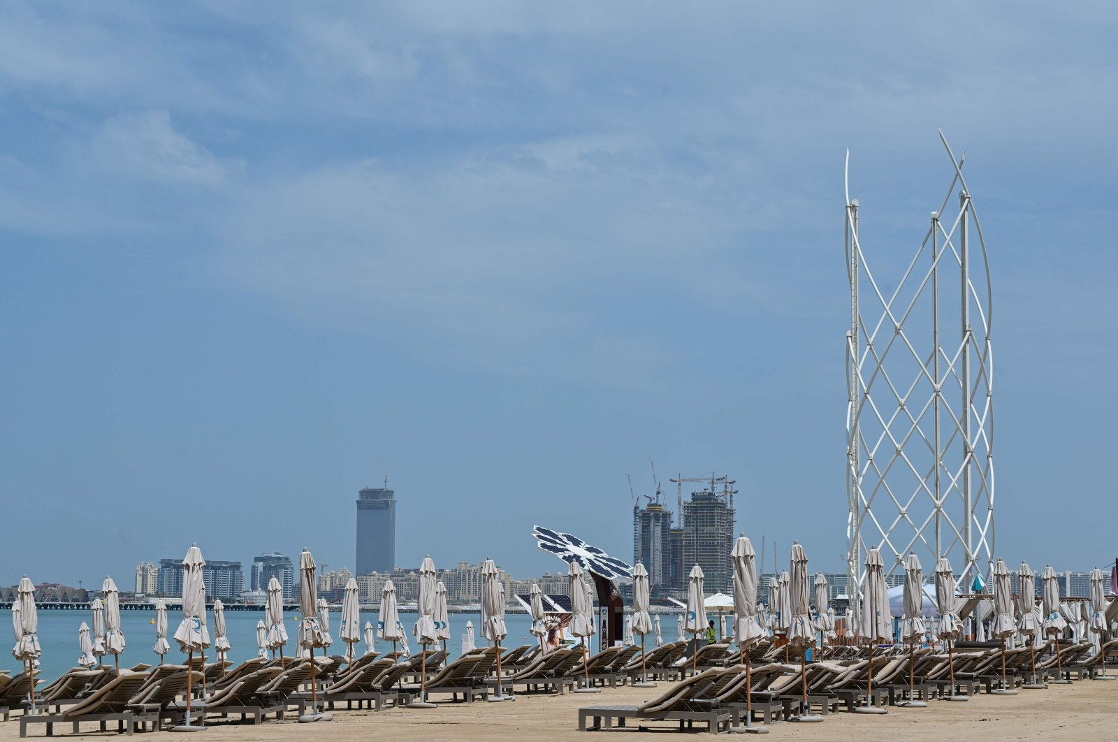 Beach chairs sit empty at Jumeirah Beach Residence in Dubai on March 22, 2020, following the closure of all beaches by authorities amid the COVID-19 pandemic. (AFP Photo)