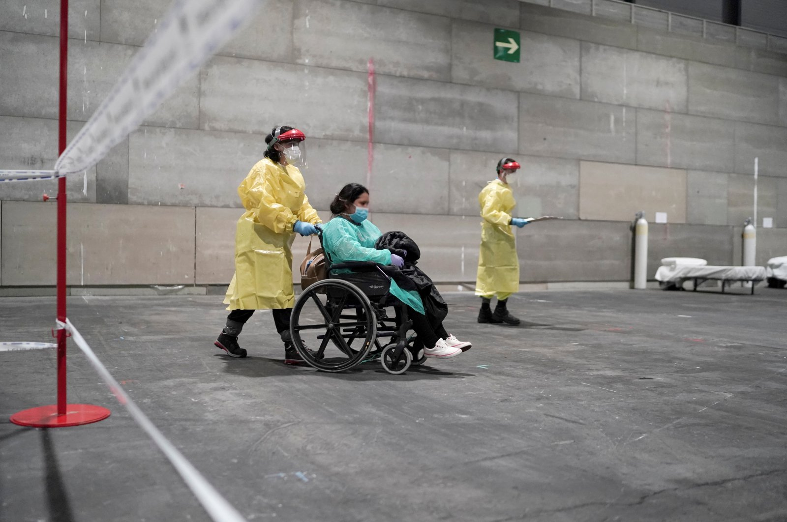 Coronavirus patients arrive at a military hospital set up at the IFEMA conference center in Madrid, Spain, March 21, 2020. Picture taken March 21, 2020. (Comunidad de Madrid/Handout via Reuters)