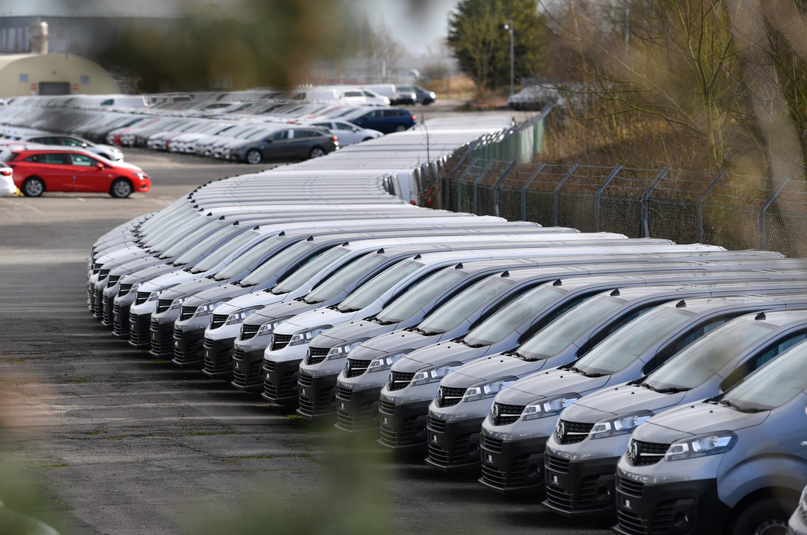 This picture shows cars parked at the Vauxhall factory in Ellesmere Port, east of Liverpool, after the owner, French automotive group PSA announced on March 16, 2020, the shutdown of all its factories in Europe during the week, due to the coronavirus. (AFP Photo)