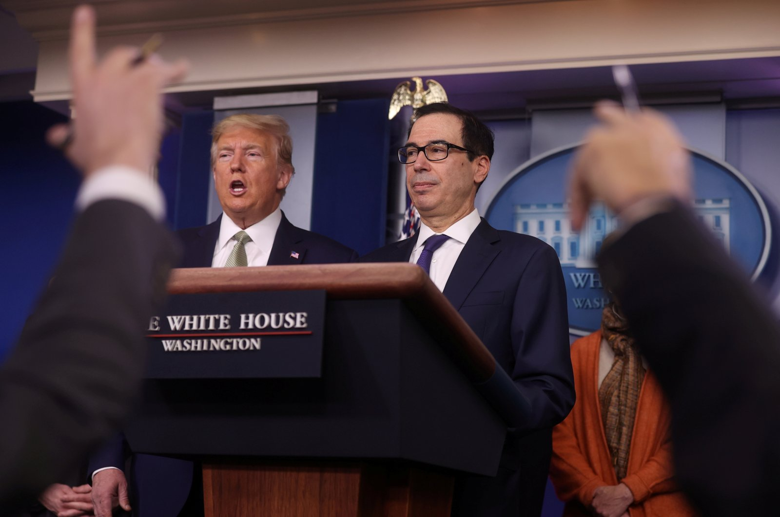 U.S. President Donald Trump and Treasury Secretary Steven Mnuchin answer questions during the Trump administration's daily coronavirus briefing at the White House in Washington, U.S., March 17, 2020. (REUTERS Photo)