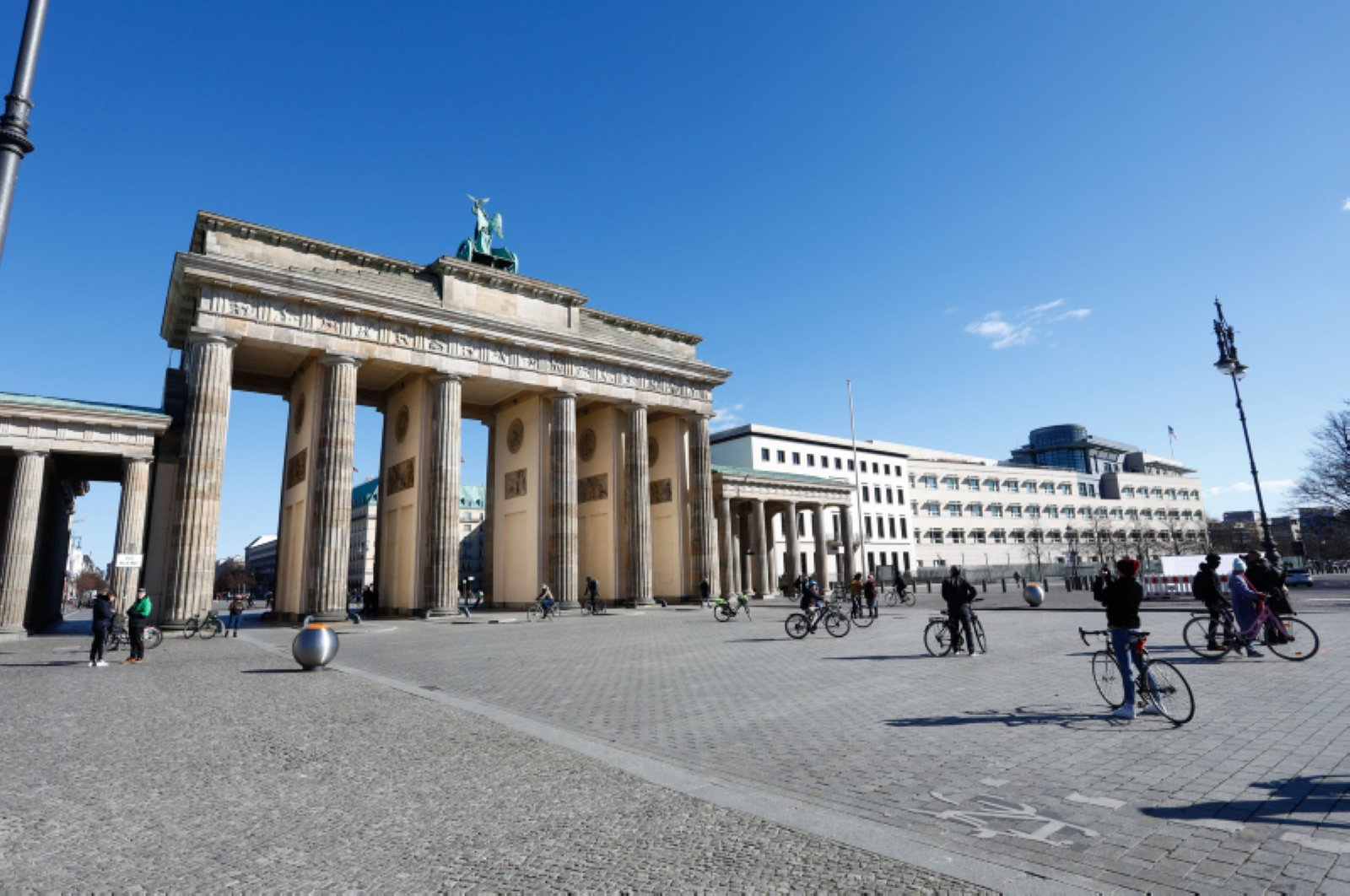 People stroll at the Pariser Platz in front of the Brandenburg Gate in Berlin, Germany, March 22, 2020, as the spread of the novel coronavirus continues. (Reuters Photo)