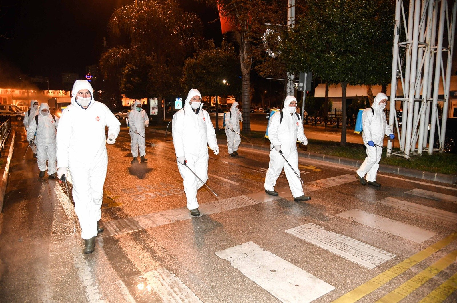Workers disinfect streets in southern Adana province. (AA Photo)