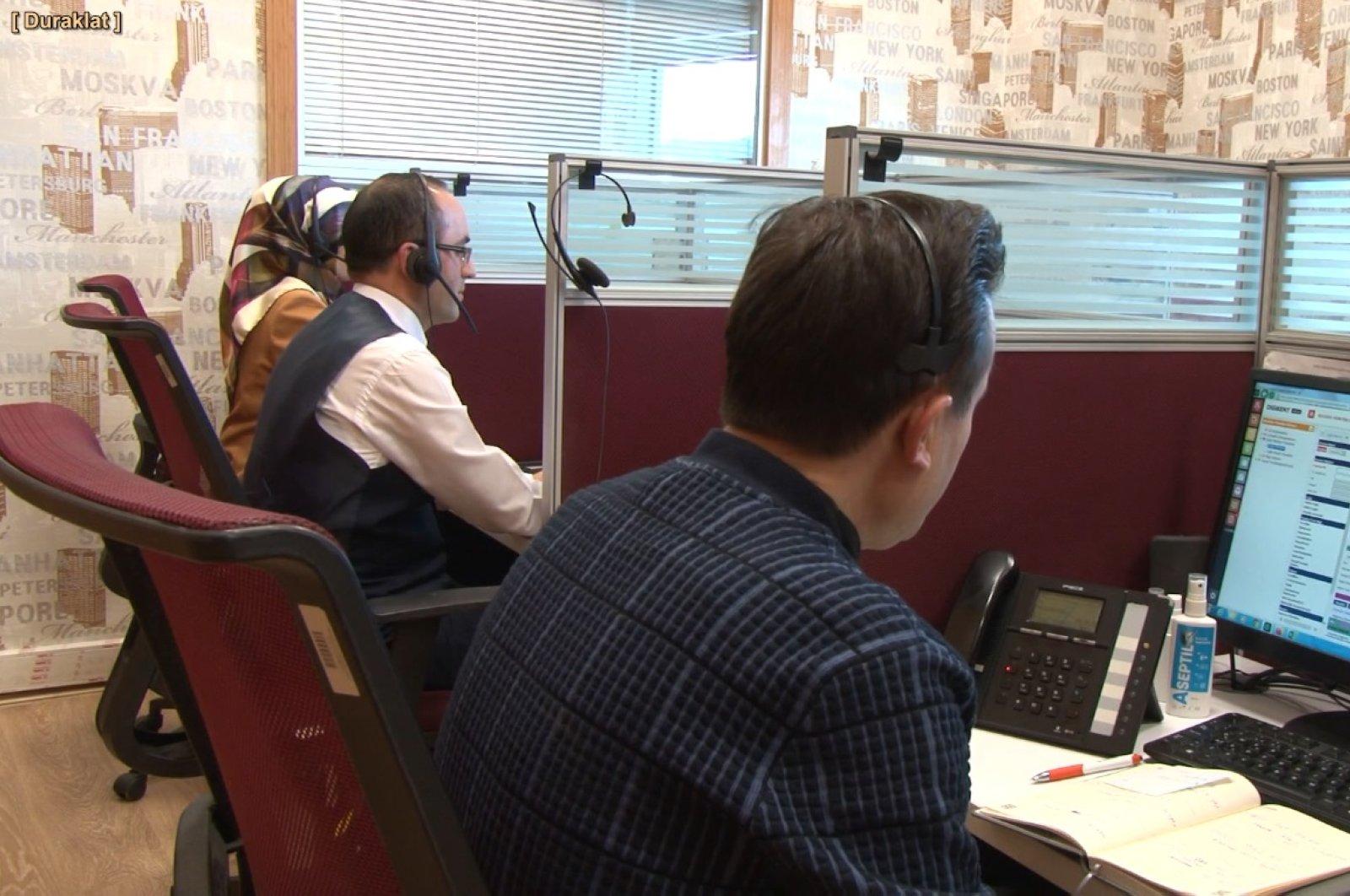 Civil servants working in a coronavirus hotline in Istanbul's Tuzla (DHA File Photo)