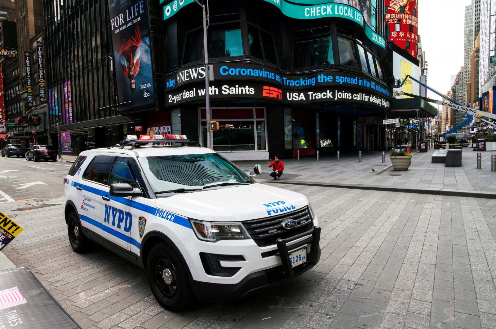 A NYPD police car stand guard at Times Square as the coronavirus disease (COVID-19) outbreak continues in New York, U.S., March 21, 2020. (Reuters Photo)