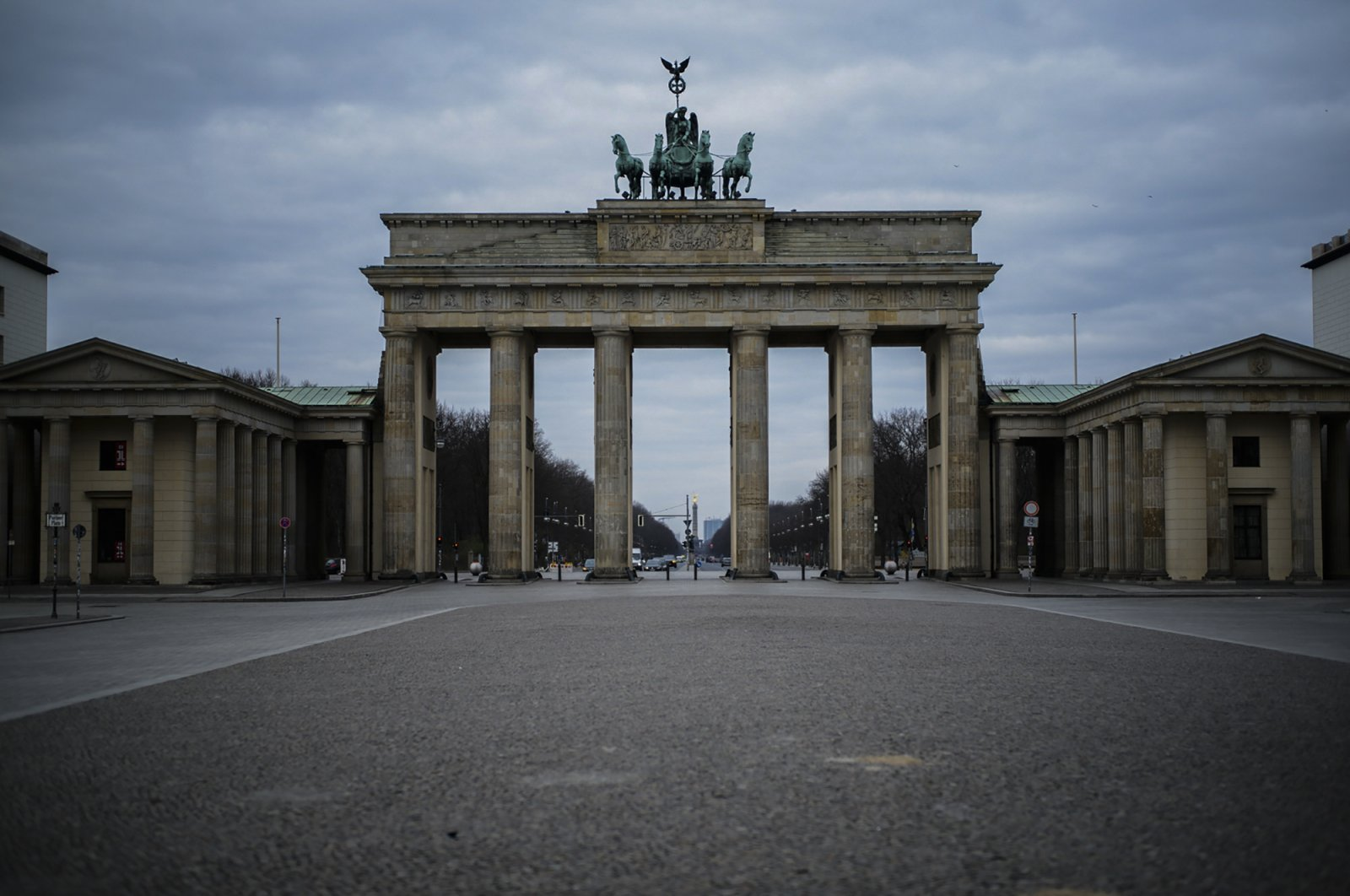 The Pariser Platz in front of the Brandenburg Gate lies empty due to the COVID-19 outbreak in Berlin, Germany, Thursday, March 19, 2020. (AP Photo)