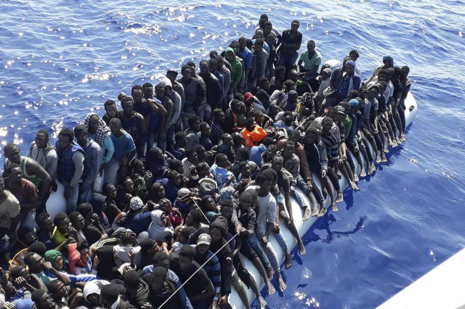 A file photo provided by the Libyan Coast Guard shows migrants on a ship intercepted offshore near the town of Gohneima, east of the capital, Tripoli, June 24, 2018. (AP Photo)