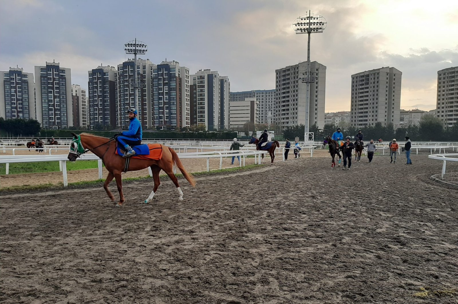 Jockeys ride horses in Veliefendi racetrack in Istanbul, Monday, March 23, 2020. (DHA Photo)
