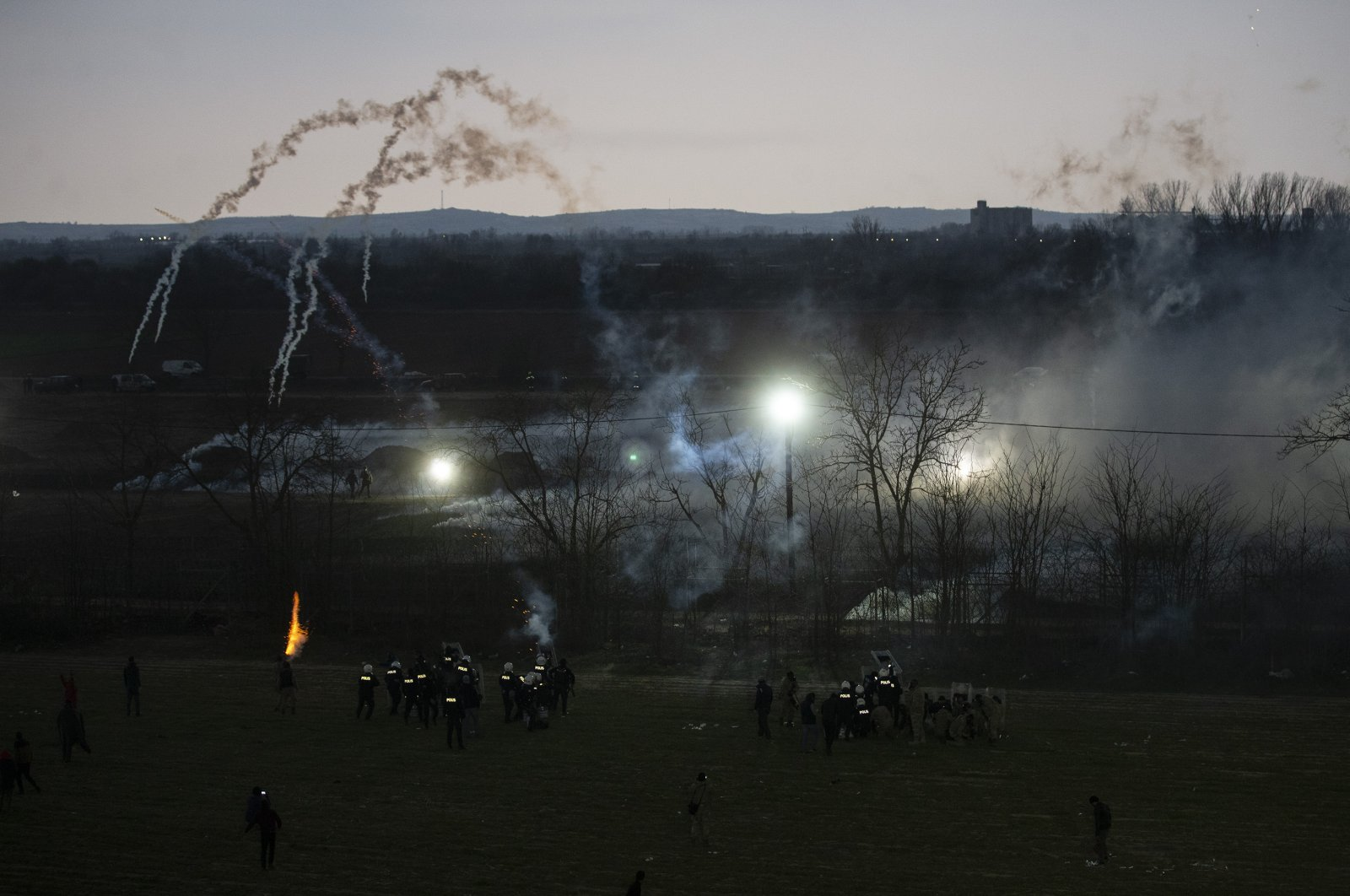 Greek border units intervened against migrants playing football near the border, Sunday, March 22, 2020. (AA Photo)