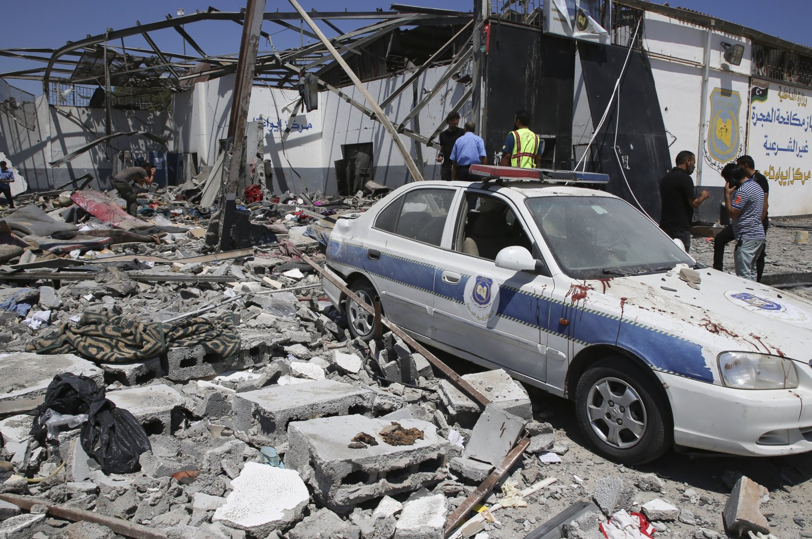 Debris covers the ground and an emergency vehicle after an airstrike at a detention center in Tajoura, east of Tripoli in Libya, July 3, 2019.  (AP)