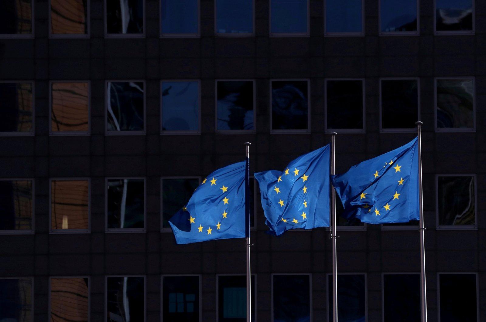 European Union flags fly outside the European Commission headquarters, Brussels, Feb. 19, 2020. (REUTERS Photo)
