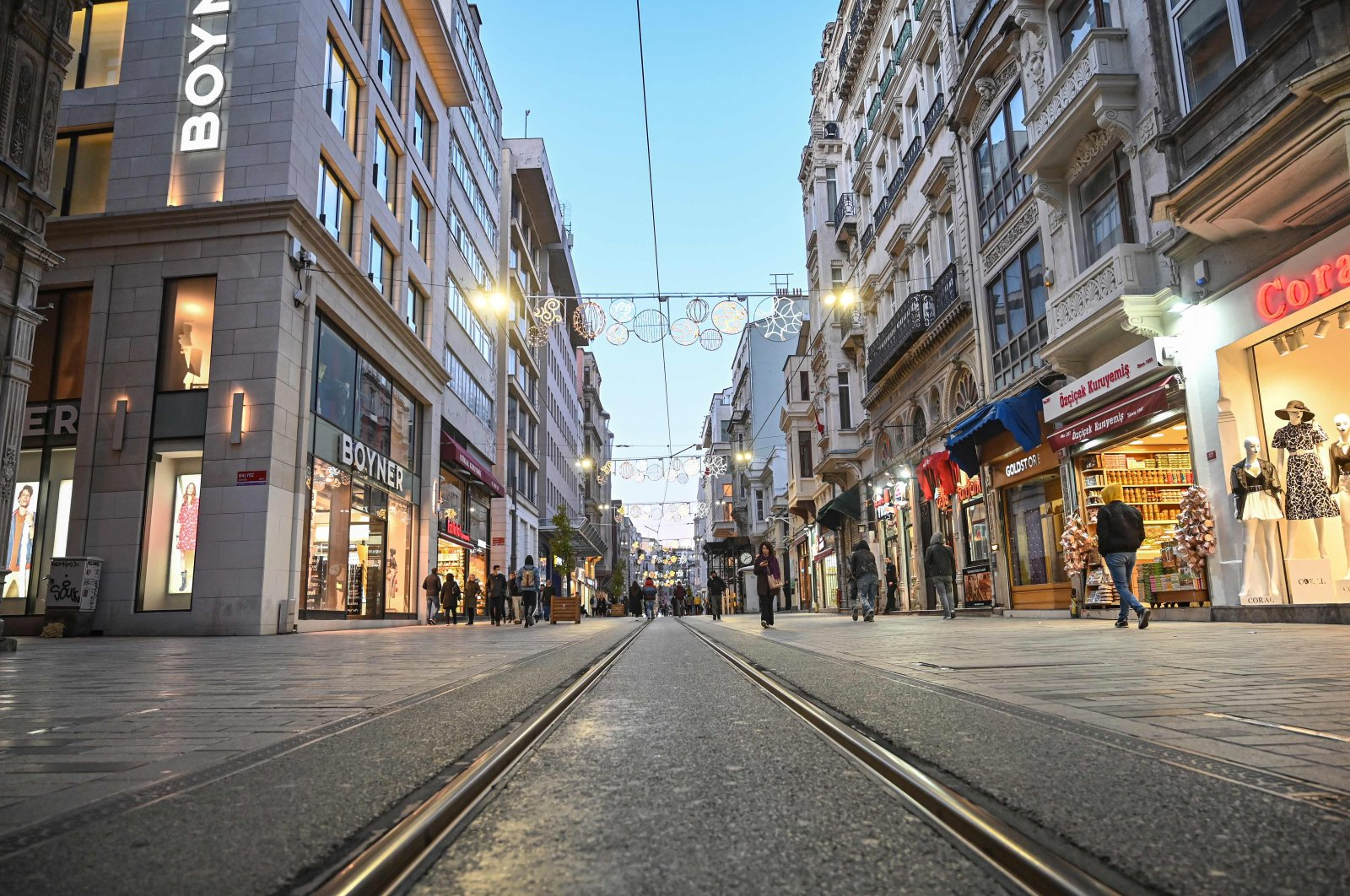 People walk along a nearly empty Istiklal Avenue amid the COVID-19 pandemic, in Istanbul, March 17, 2020. (AFP Photo)