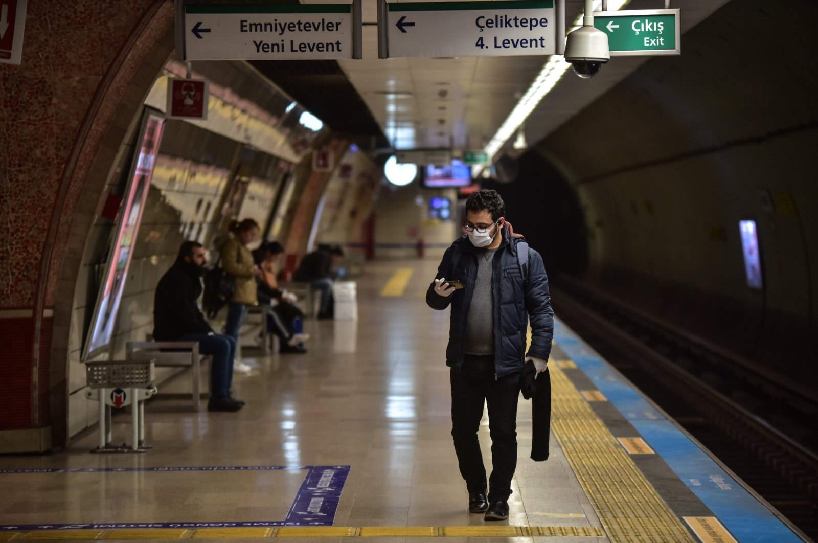 A man wearing a mask walks at a metro station, Monday, March 23, 2020, in Istanbul. (DHA Photo)