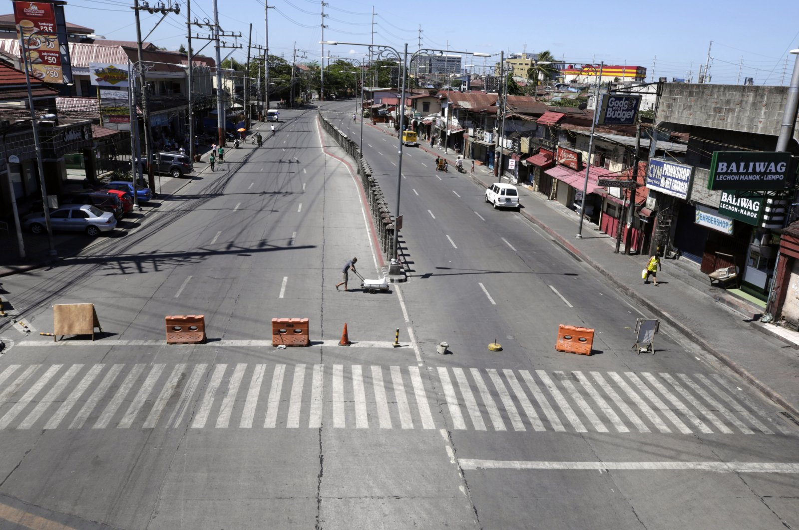 View of an empty road in Bacoor, Philippines, March 23, 2020. (EPA Photo)