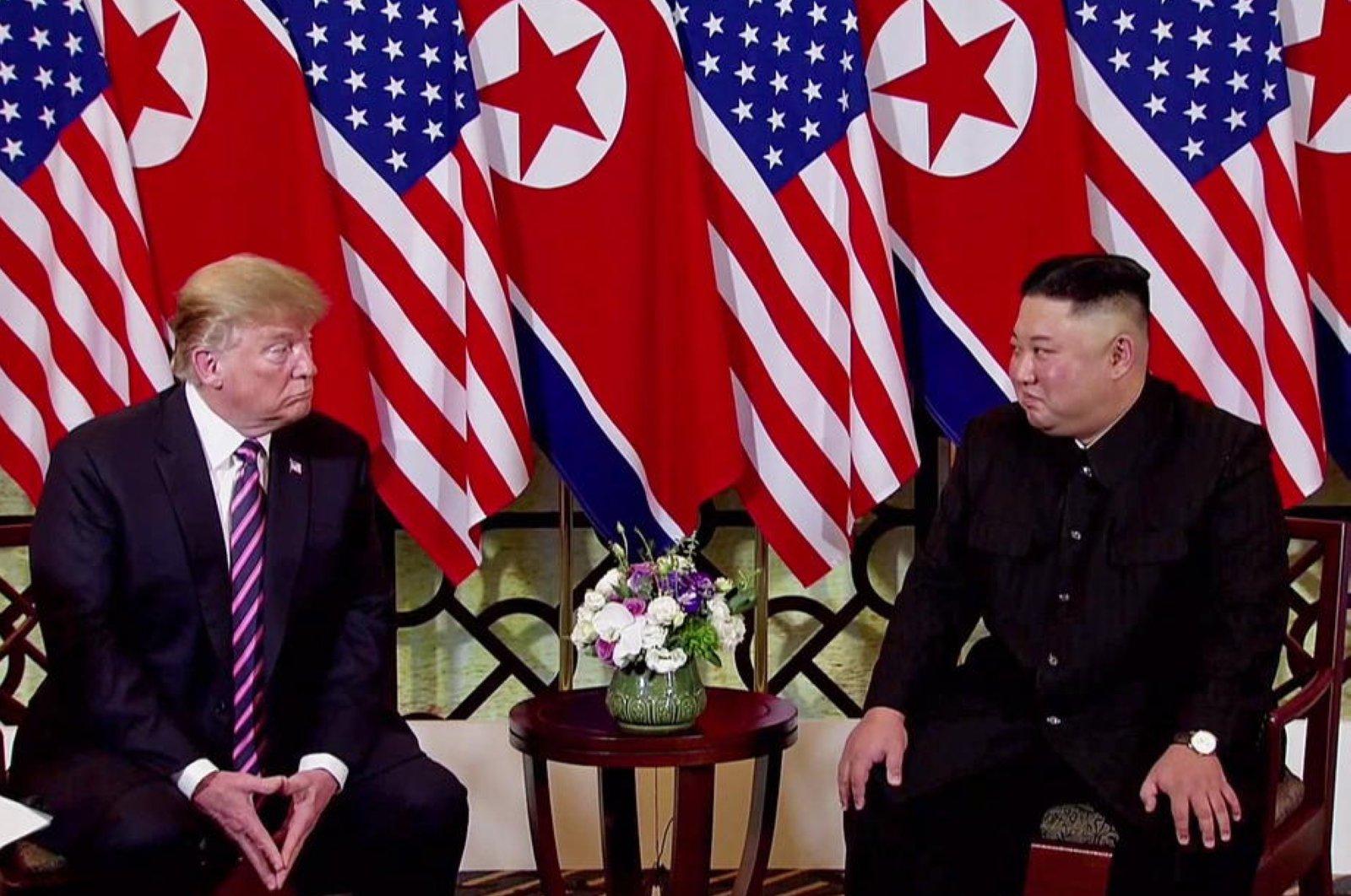 North Korean leader Kim Jong Un (R) and U.S. President Donald Trump (L) exchange glances during the second U.S.-North Korea summit, Hanoi, Feb. 27 2019. (EPA Photo)