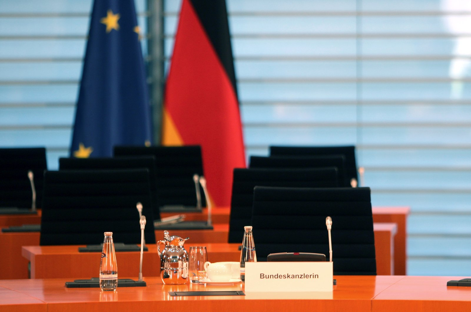 The empty seat of German Chancellor Angela Merkel, who is in home quarantine during the weekly cabinet meeting in Berlin, Germany, Monday, March 23, 2020. (EPA Photo)