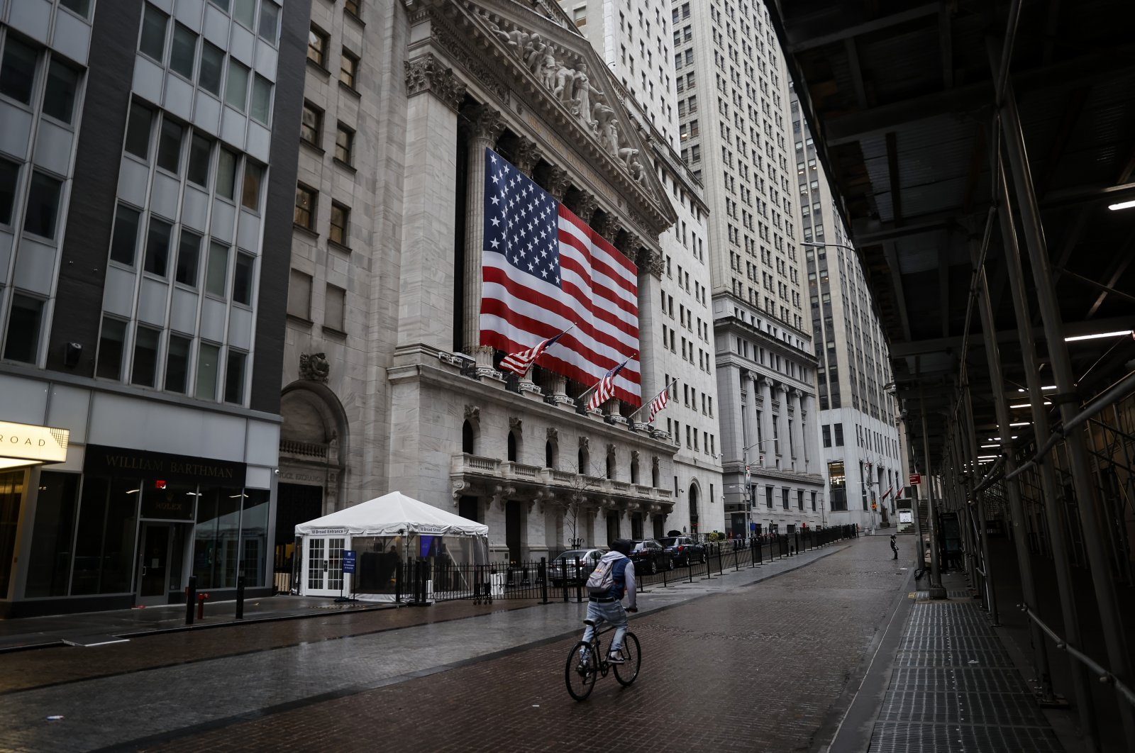 A man rides his bike  in front of  the New York Stock Exchange in New York City, New York, March 23, 2020. (REUTERS Photo)