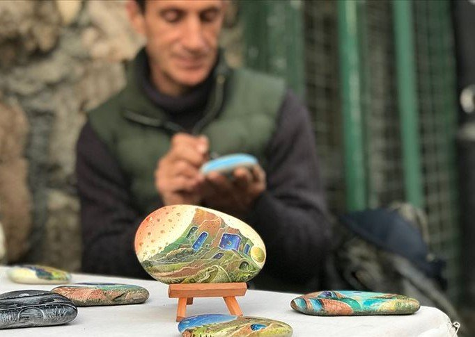Some stones depicting picturesque views by Erdal Parlaklı. (AA Photo)