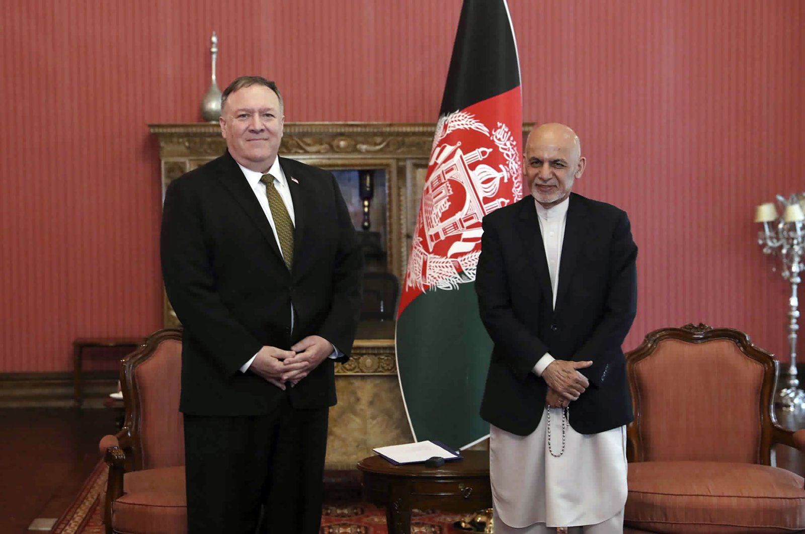 U.S. Secretary of State Mike Pompeo, left, stands with Afghan President Ashraf Ghani, at the Presidential Palace in Kabul, Afghanistan, Monday, March 23, 2020. (Afghan Presidential Palace via AP)