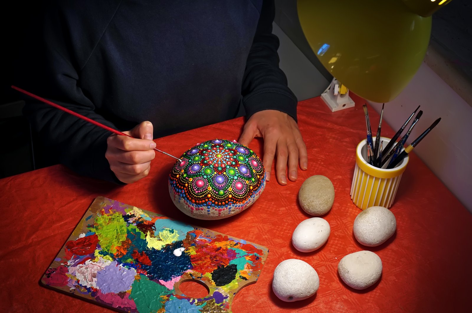 All you need for stone painting are brushes and acrylic paints. (iStock Photo)