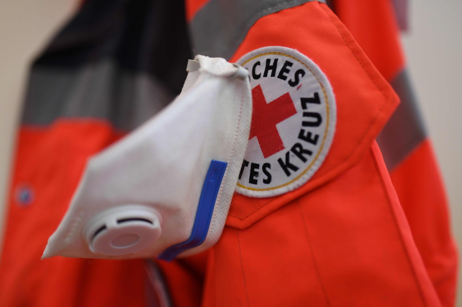 An FFP3 protective mask hangs on a jacket of the German Red Cross at the former St. Marien hospital in Laer near Steinfurt, Saturday, March 21, 2020. (AFP Photo)