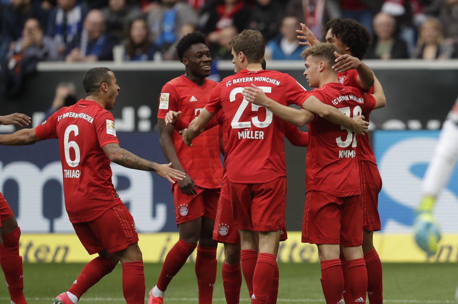 Bayern's players celebrate after a goal during a Bundesliga match against TSG 1899 Hoffenheim in Sinsheim, Germany, Feb. 29, 2020. (AP Photo)