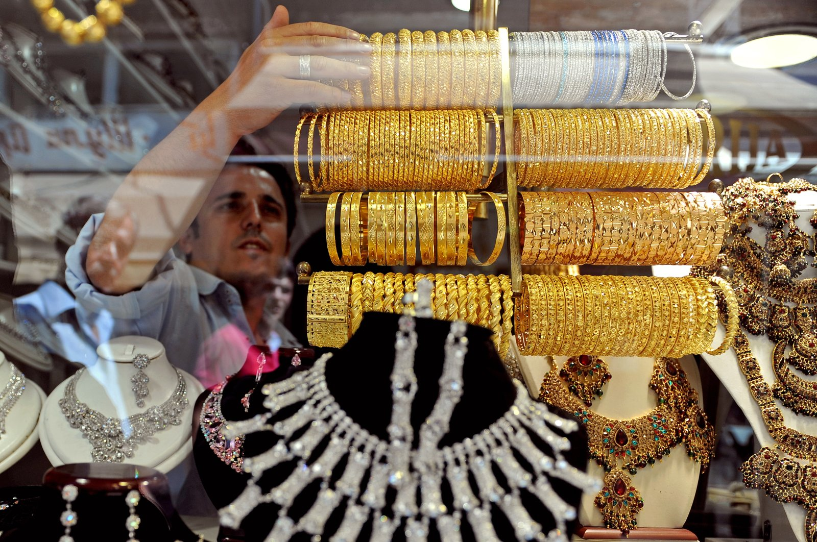 A worker at a jewelry store sets up the showcase in one of the many shops in the old Turkish bazaar in the capital Skopje, North Macedonia, Aug. 19, 2011. (EPA Photo)