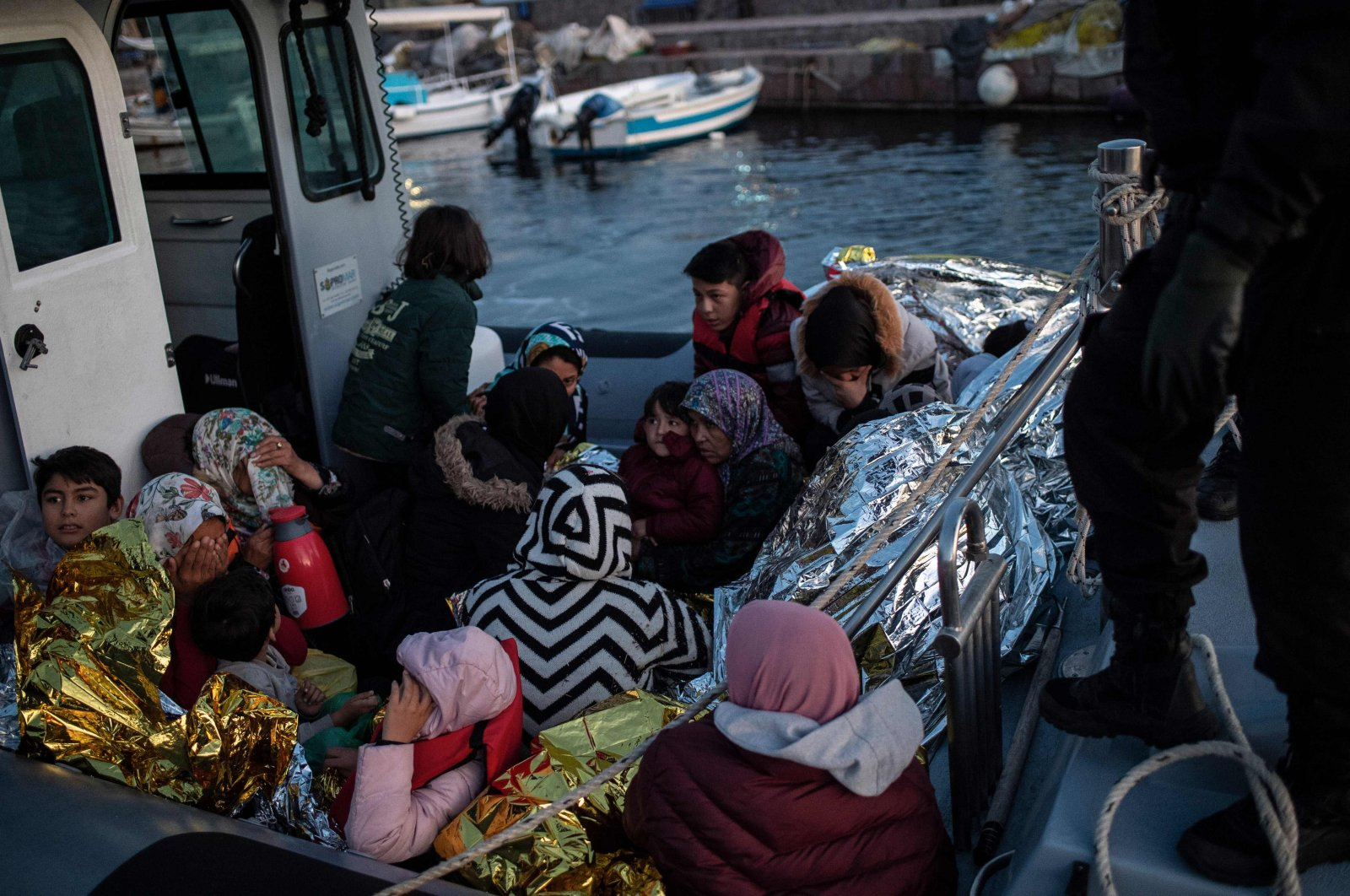 Migrants aboard a rescue boat at the port of Skala Sikamias on the island of Lesbos, Sept. 29, 2019. (AFP Photo)