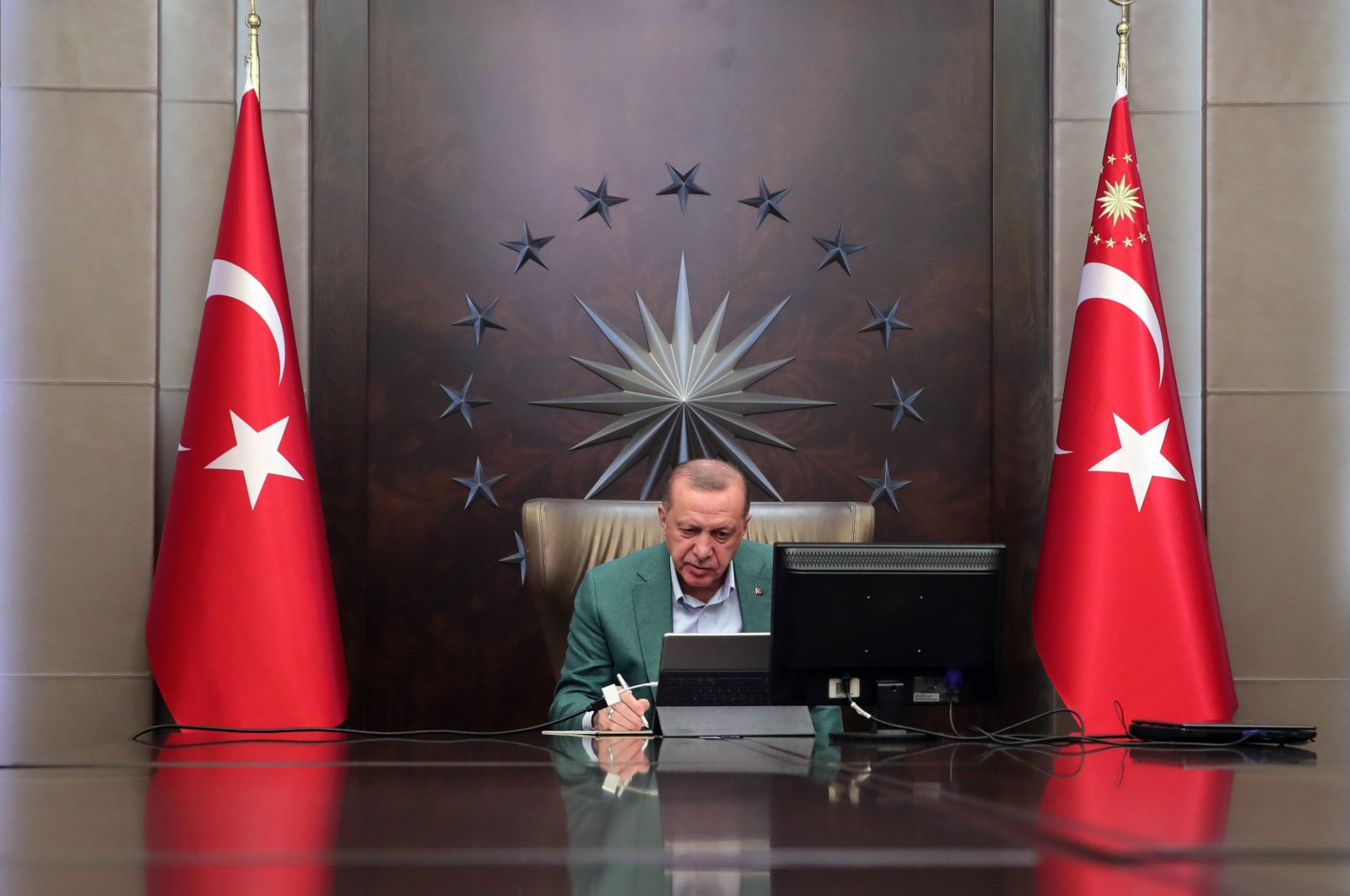 President Recep Tayyip Erdoğan participates in a teleconference with his Cabinet amid the coronavirus outbreak, in Ankara, Turkey, Monday, March 23, 2020. (IHA Photo)