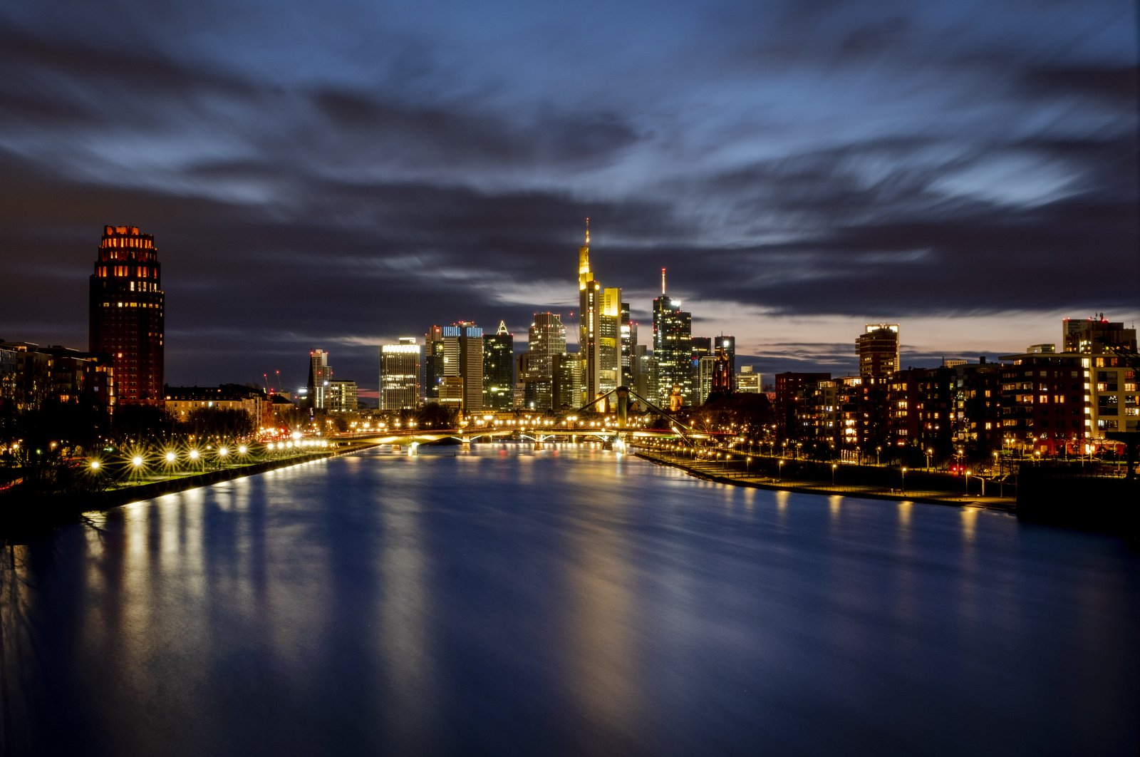 The buildings of the banking district are seen along the river Main in Frankfurt, Germany, Saturday, March 21, 2020. (AP Photo)