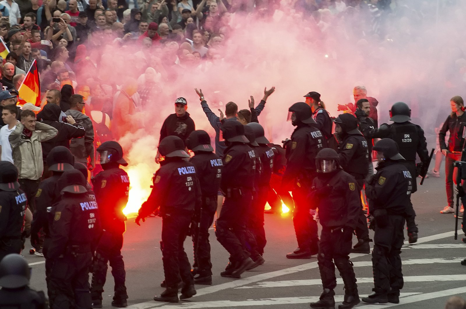 Protesters light fireworks during a far-right demonstrations, Chemnitz, Aug. 27, 2018. (AP Photo)