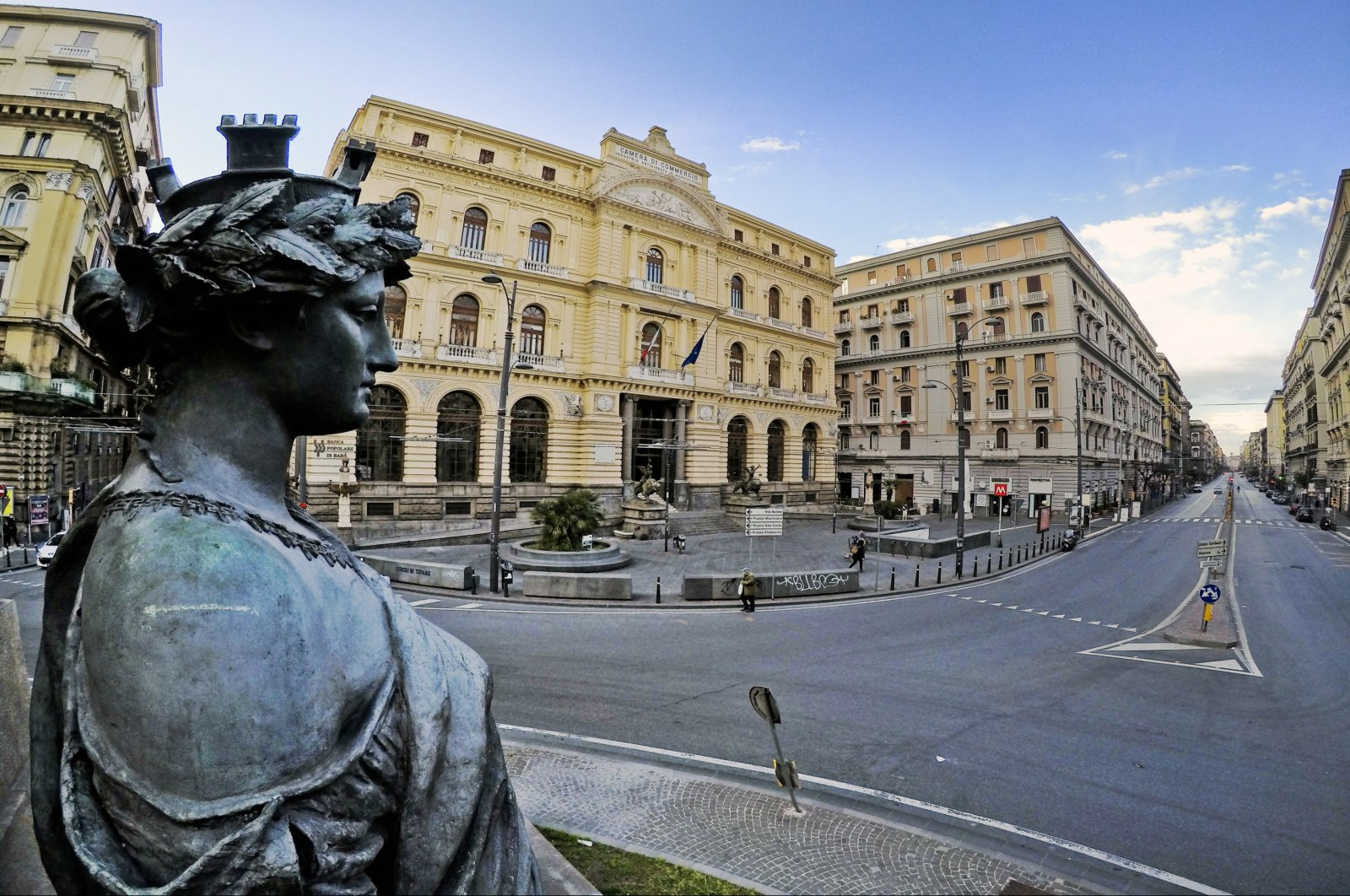 The statue of Goddess Phartenope seems to look down the street Corso Umberto in Naples, Italy, 24 March 2020, where the road is normally full of cars and now semi-deserted due to the blocking of the circulation wanted by the Government to stem the danger of contagion from coronavirus (EPA Photo)