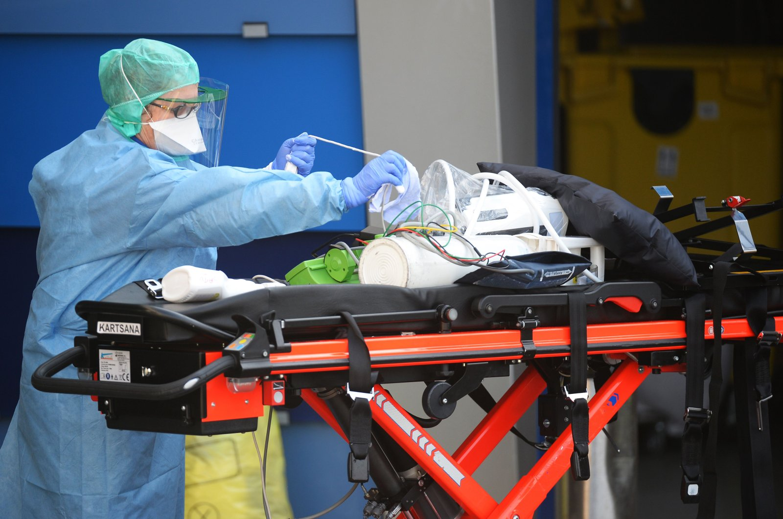 A nurse anesthetist disinfects material of ambulances which carried six coronavirus patients at the Brest hospital, evacuated by air from the French eastern city of Mulhouse, in Brest, western France, on March 24, 2020, on the eight day of a lockdown aimed at curbing the spread of the COVID-19 (novel coronavirus) in France. (AFP Photo)