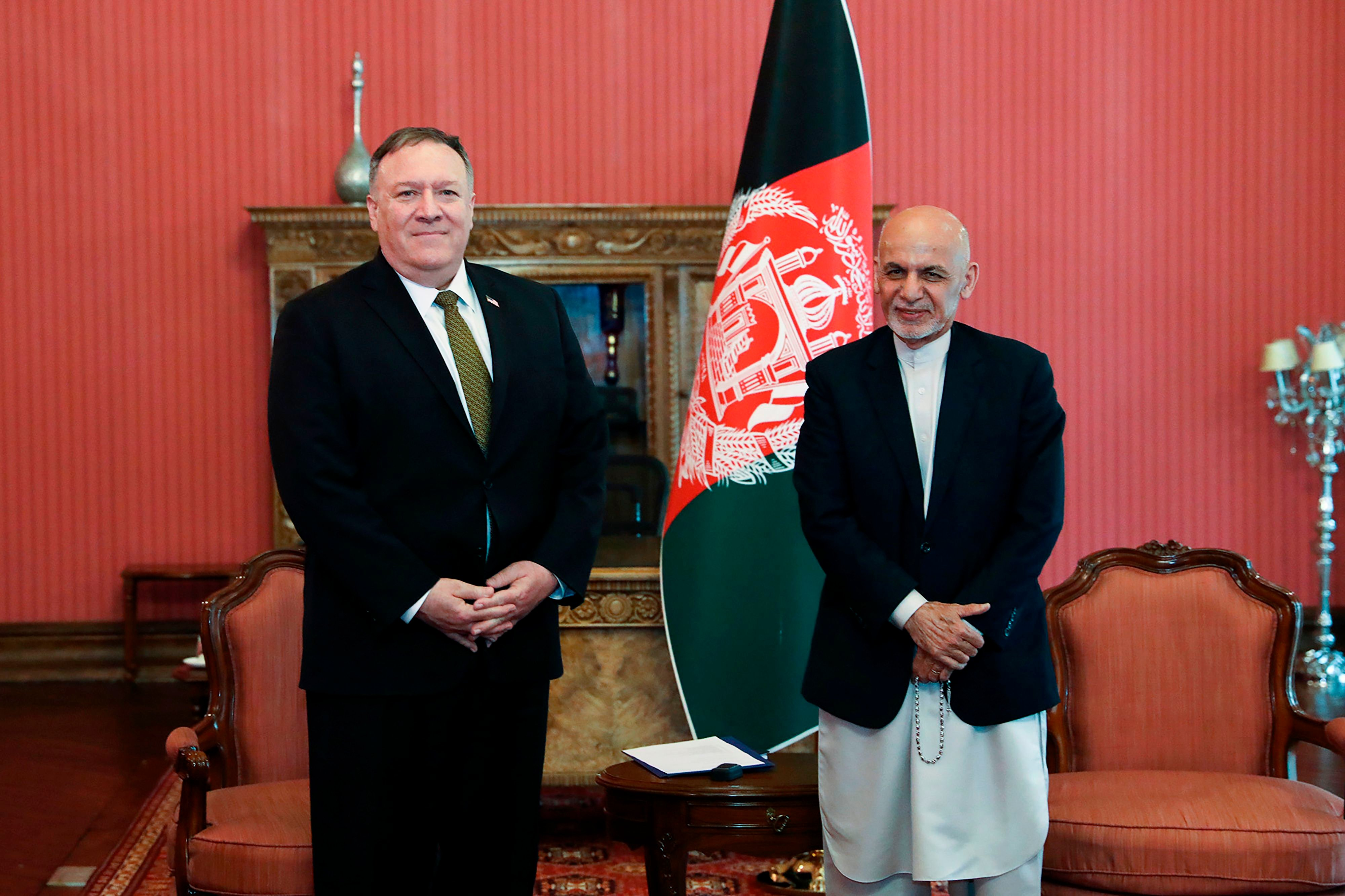 Afghanistan's President Ashraf Ghani poses for a picture with US Secretary of State Mike Pompeo (L) during their meeting in Kabul,  Monday, March 23, 2020. (AFP)