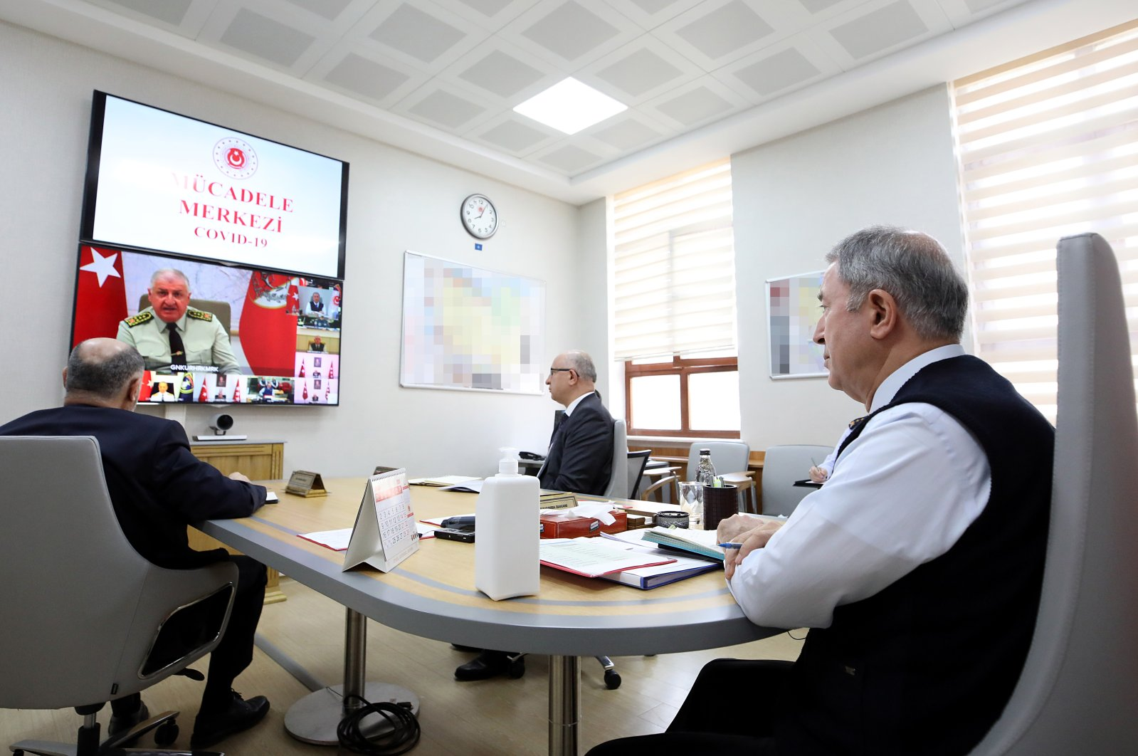 Defense Minister Hulusi Akar holds teleconference with military officials at the Anti-Coronavirus Fight Center (KOMMER) in Ankara on Tuesday, March 24, 2020 (AA Photo)