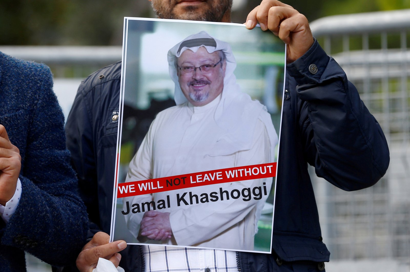 A demonstrator holds a picture of Saudi journalist Jamal Khashoggi during a protest in front of Saudi Arabia's consulate in Istanbul, Oct. 5, 2018. (Reuters Photo)