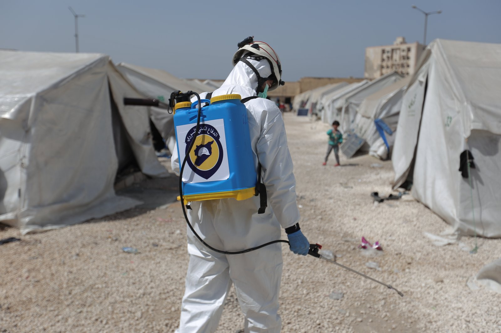 White Helmets civil defense teams try to conduct disinfection works in crowded camps and buildings in Syria's Idlib, March 24, 2020. (AA Photo)