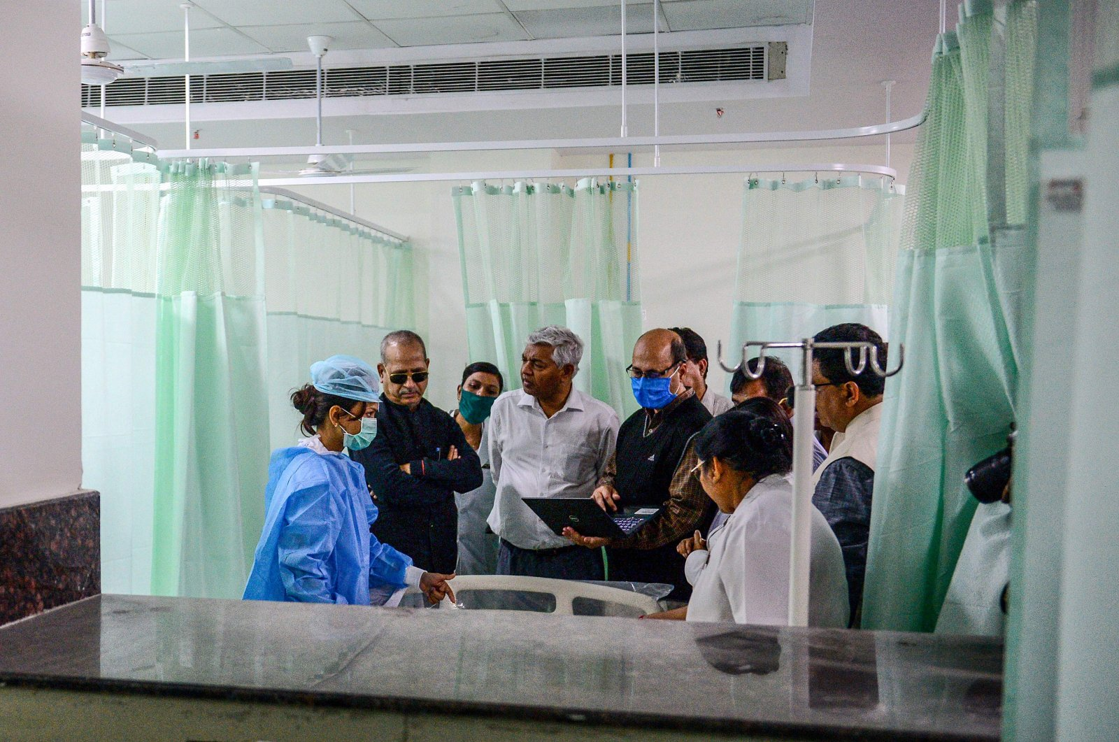 Health department officials and doctors participate in a mock drill practice with a mock patient at SRN Hospital, Allahabad, Wednesday, March 18, 2020. (AFP Photo)