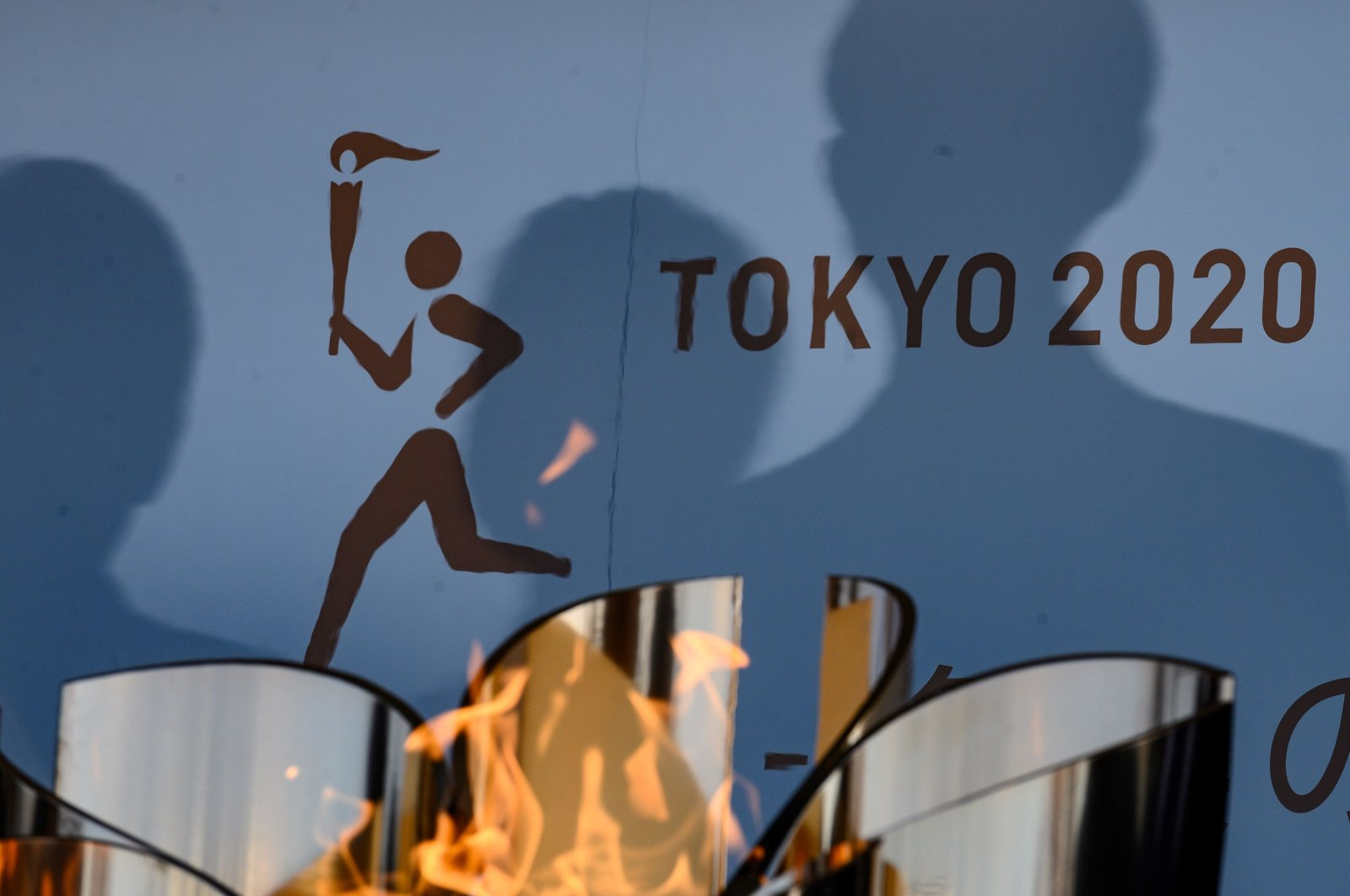 The logo for the Tokyo 2020 torch relay is pictured as the Olympic flame goes on display at the Aquamarine Fukushima aquarium in Iwaki in Fukushima prefecture, Japan, Wednesday, March 25, 2020. (AFP Photo)