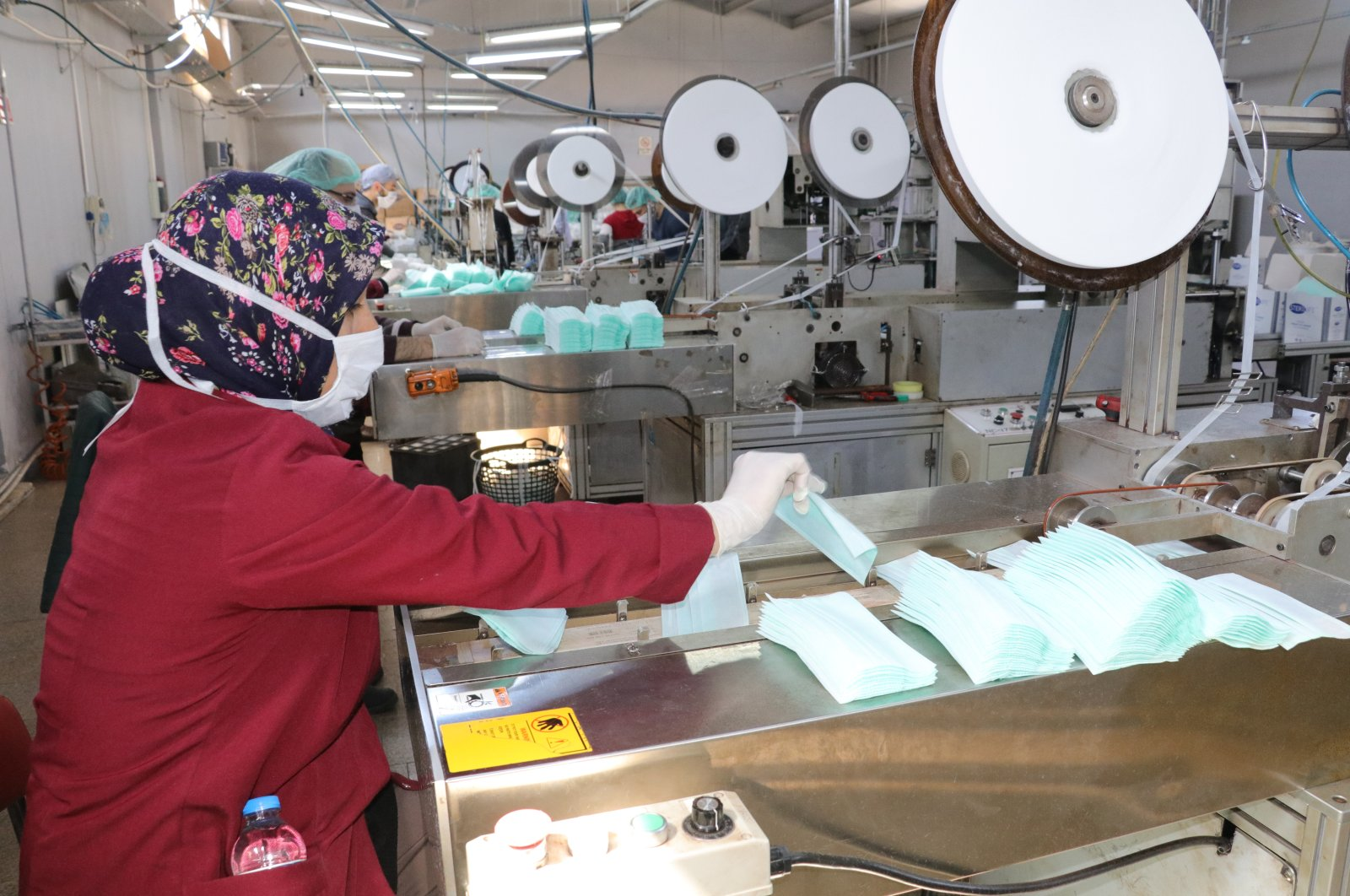 Workers are seen in a firm that manufactures health supplies in Turkey's central province of Yozgat, Wednesday, March 25, 2020. (AA Photo)