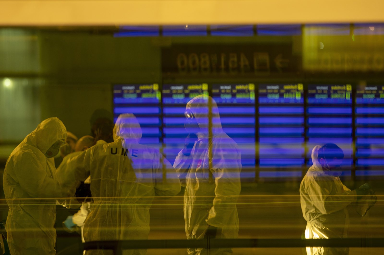Spanish UME (Emergency Army Unit) soldiers disinfect a terminal to prevent the spread of the coronavirus at an airport in Barcelona, Spain, Thursday, March 19, 2020. (AP Photo)
