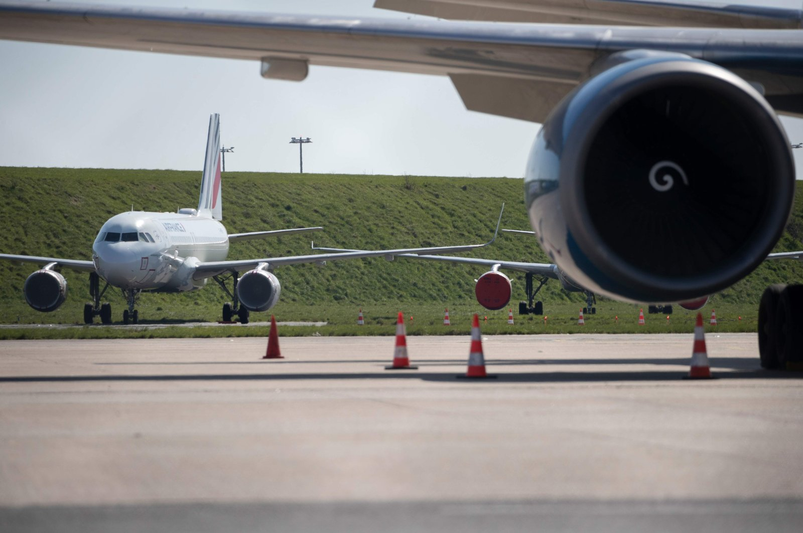 A picture shows grounded airplanes at the Roissy-Charles de Gaulle airport in Roissy-en-France, north of Paris, on the eight day of a lockdown aimed at curbing the spread of the COVID-19 in France, Tuesday, March 24, 2020. (AFP Photo)